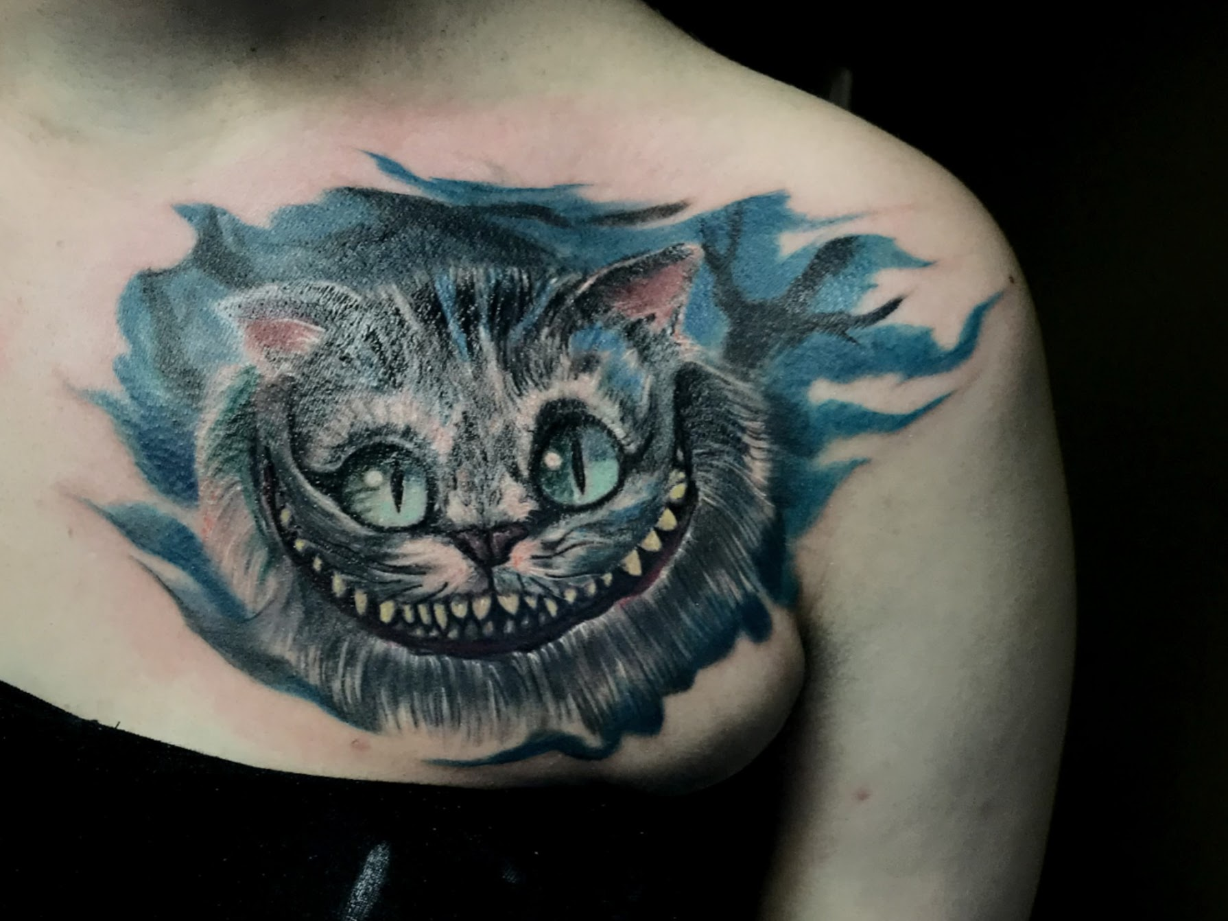 Tattoo-Grinsekatze